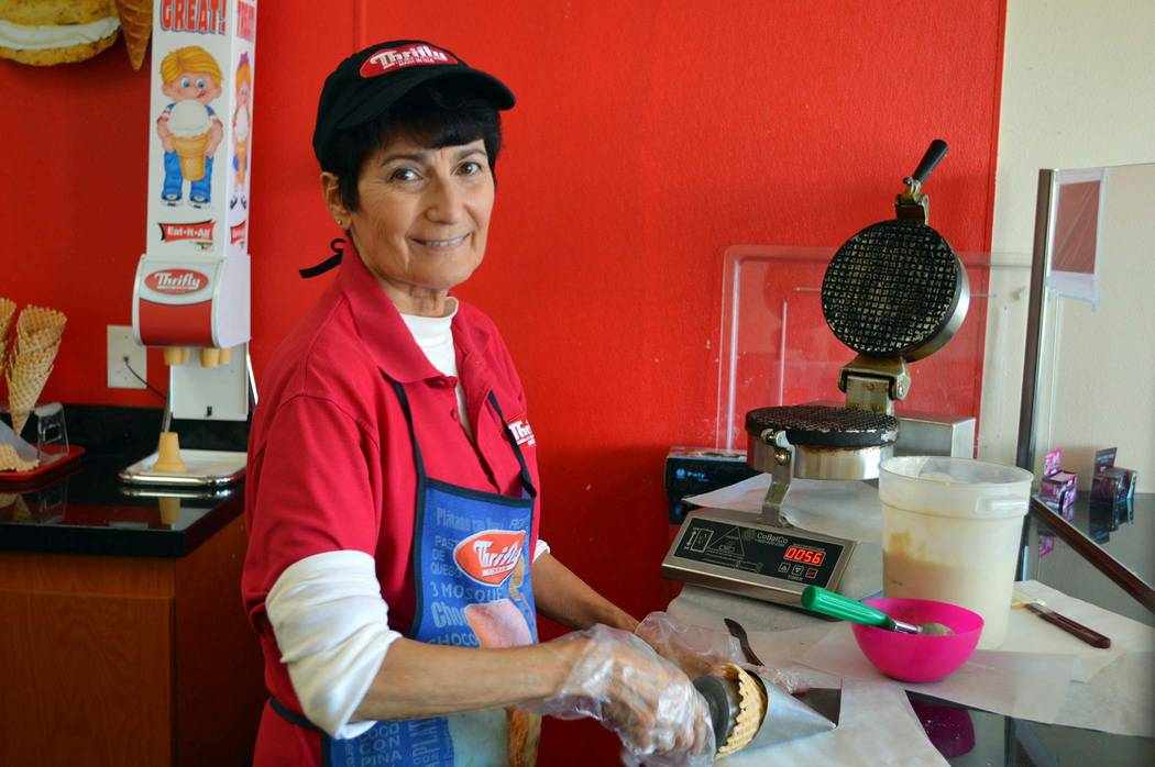 Celia Shortt Goodyear/Boulder City Review Rosa Puleo makes waffle cones at Scoops in Boulder City. The business is one place in town to cool down during the heat.