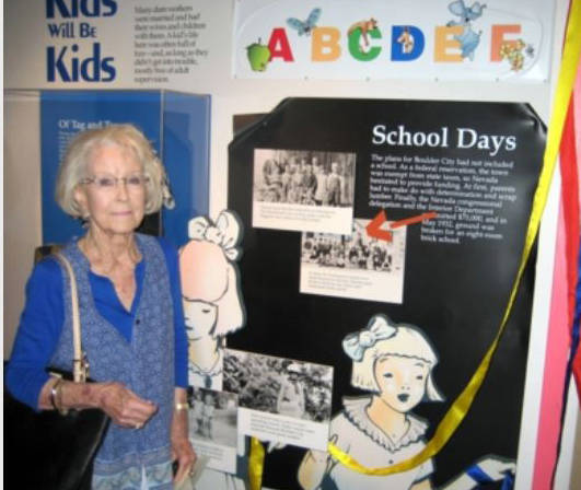 Jim Widner Mary Jane Carter Richey Smith, who graduated from Boulder City High School in 1943, stands next to an exhibit in the Boulder City-Hoover Dam Museum that features a picture of her when s ...