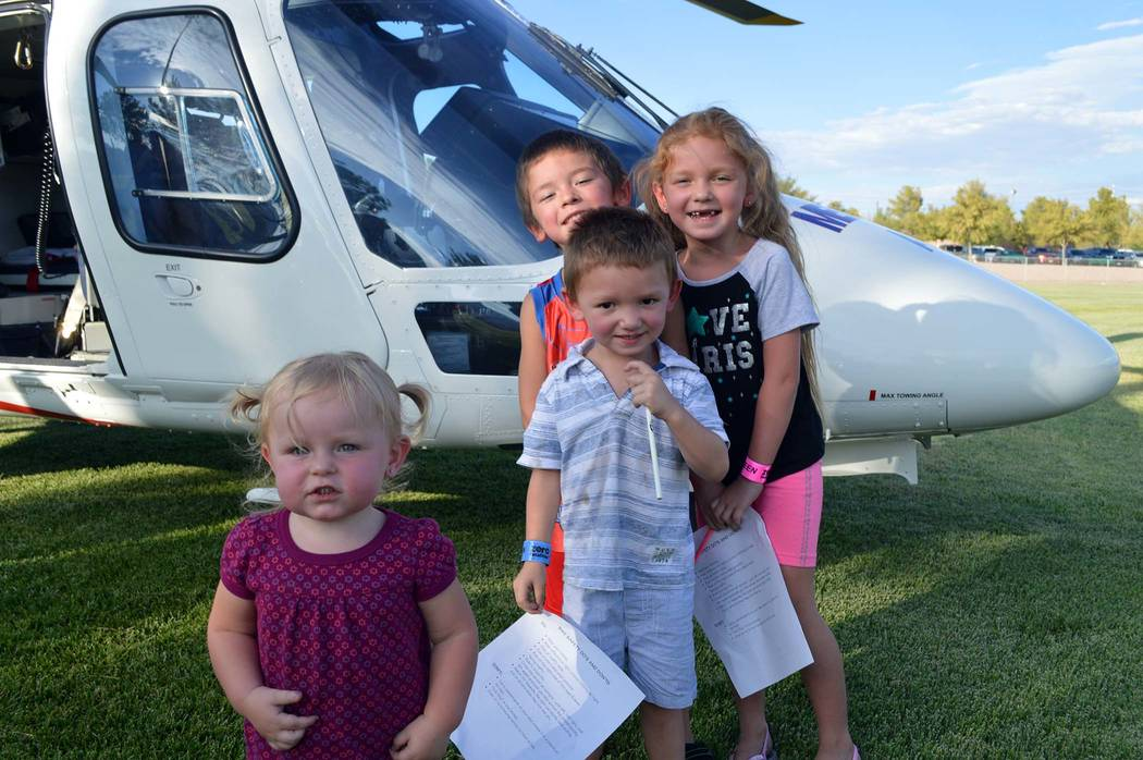 Celia Shortt Goodyear/Boulder City Review The Gardner siblings, from left, Alenna, Jacob, Johnny, and Kylie, enjoy hanging around the Mercy Air helicopter at National Night Out.