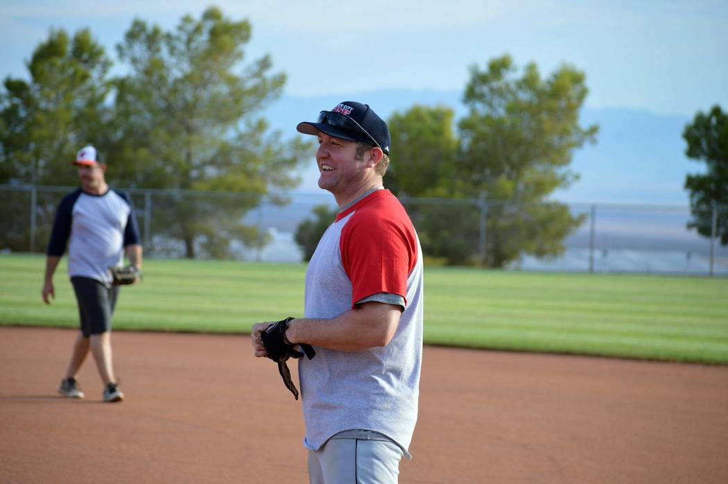 Celia Shortt Goodyear/Boulder City Review  Justin Clift smiles after reaching first base during the softball game pitting Boulder City Police and Fire personnel against Boulder City High School al ...