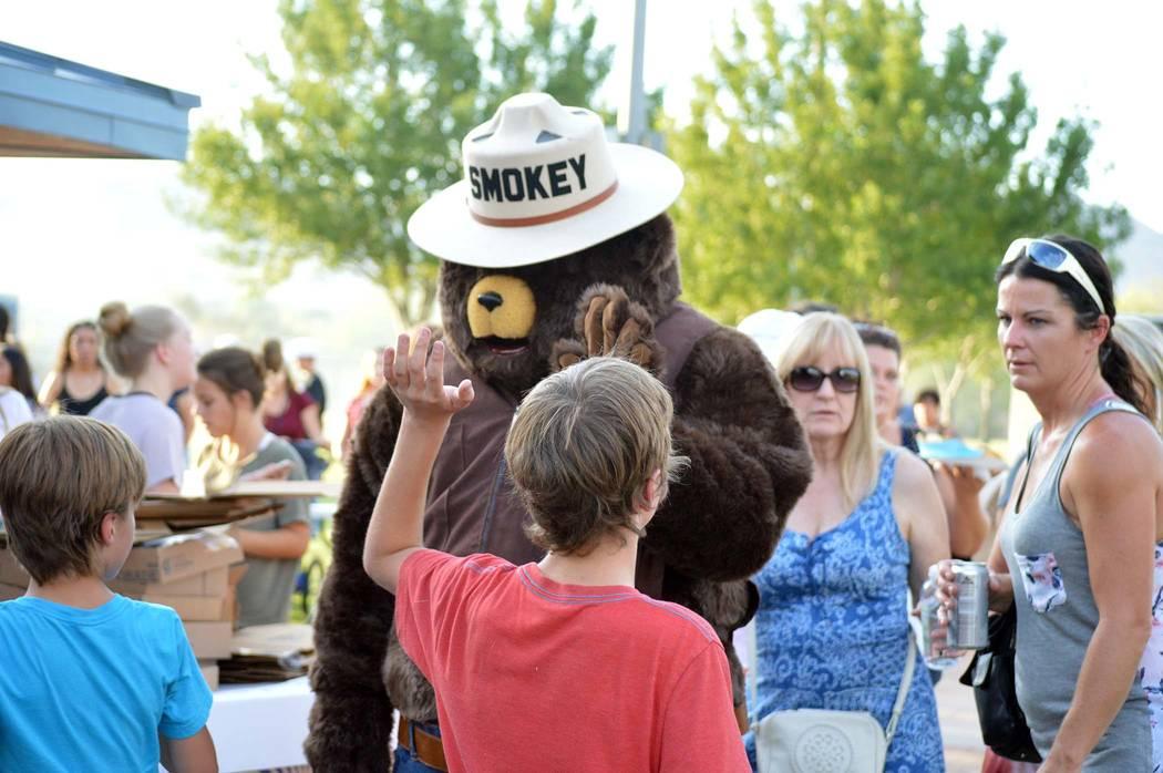 Celia Shortt Goodyear/Boulder City Review Smokey Bear greets children and their parents during National Night Out.