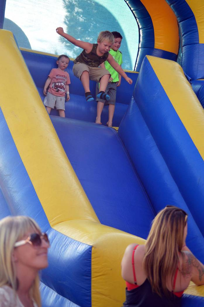 Celia Shortt Goodyear/Boulder City Review Five-year-old Gunner Gallup jumps down the inflatable slide Tuesday evening during National Night Out at Veterans' Memorial Park.