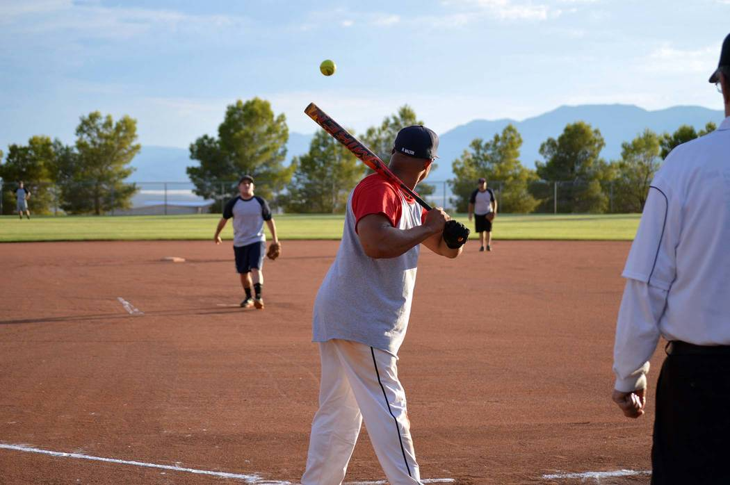 Celia Shortt Goodyear/Boulder City Review Firefighter Harold Hadley eyes the pitch and prepares to swing during the softball game featuring Boulder City Police and Fire personnel and Boulder City  ...