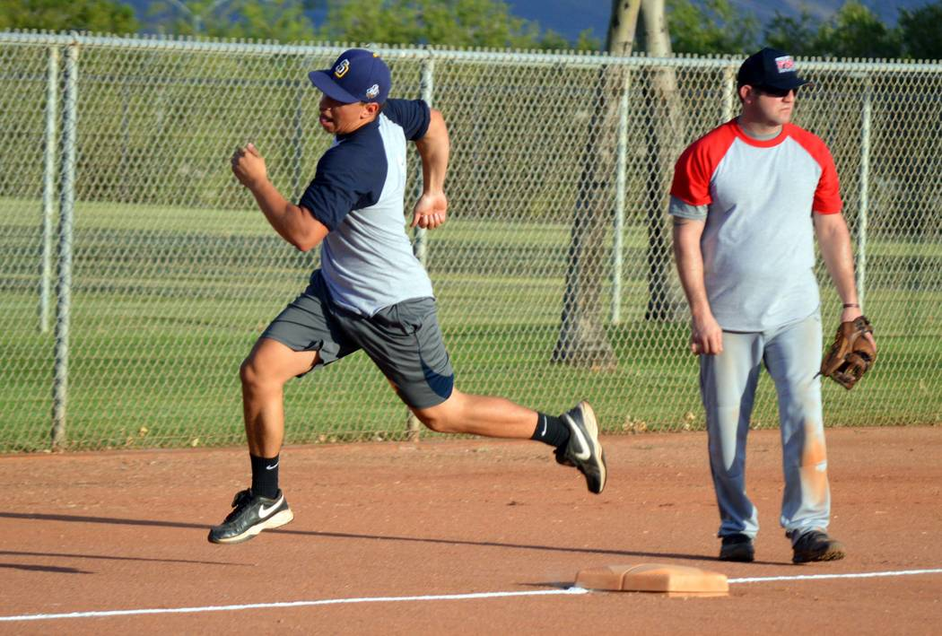 Celia Shortt Goodyear/Boulder City Review Mario Castanon, playing for the Boulder City High School alumni team, rounds third base to run home during Tuesday's softball game at National Night Out.