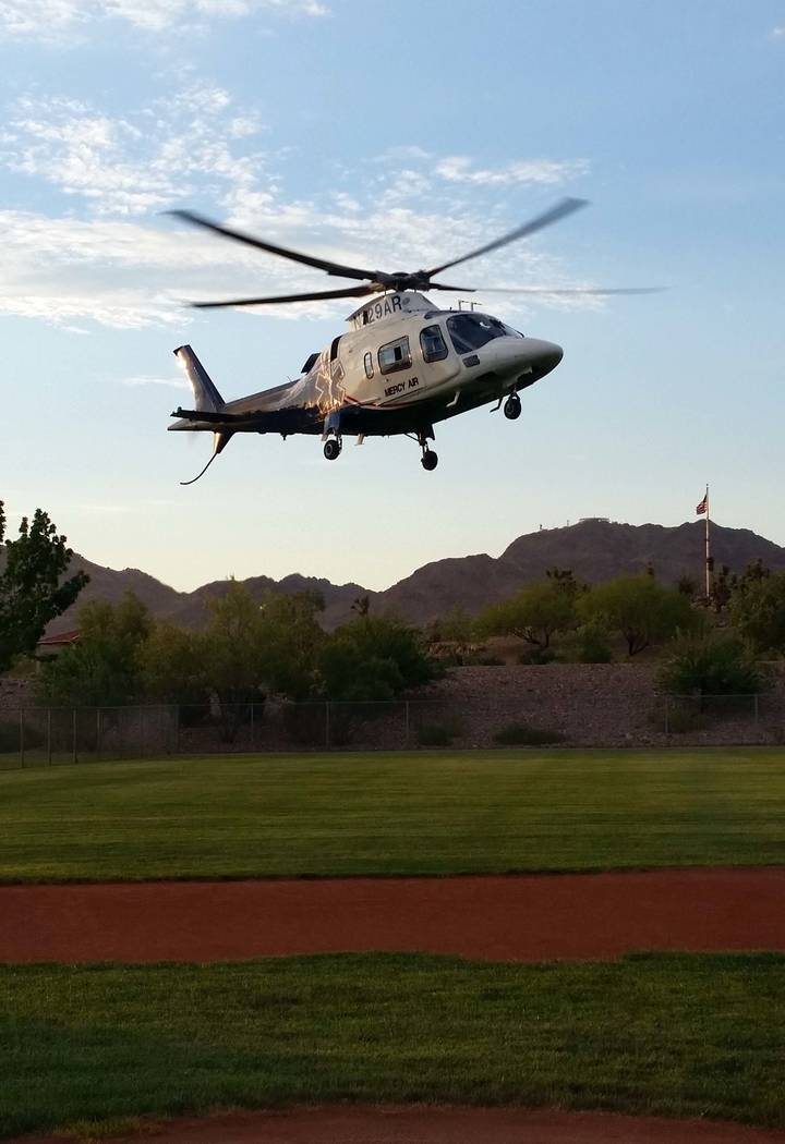 Celia Shortt Goodyear/Boulder City Review The Mercy Air helicopter takes off from a field at Veterans' Memorial Park during National Night Out.
