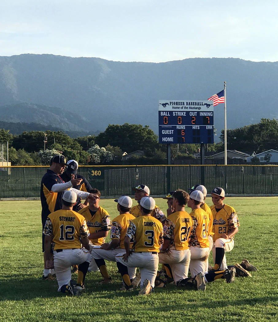 Katie Kilar Boulder City Junior Little League head coach Don Trumble addresses his players after the team's 7-6 victory over Snow City, Utah, on Aug. 2.