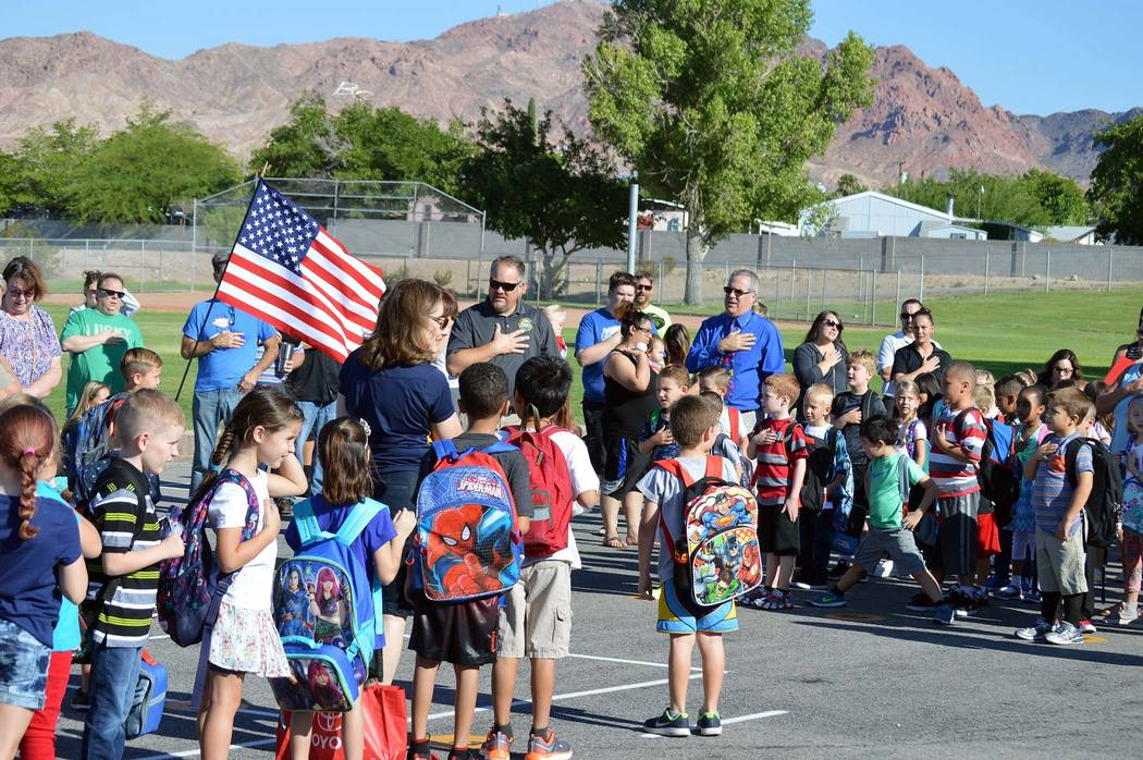 Celia Shortt Goodyear/Boulder City Review Students and parents at Mitchell Elementary School say the Pledge of Allegiance at the first day of school on Monday.