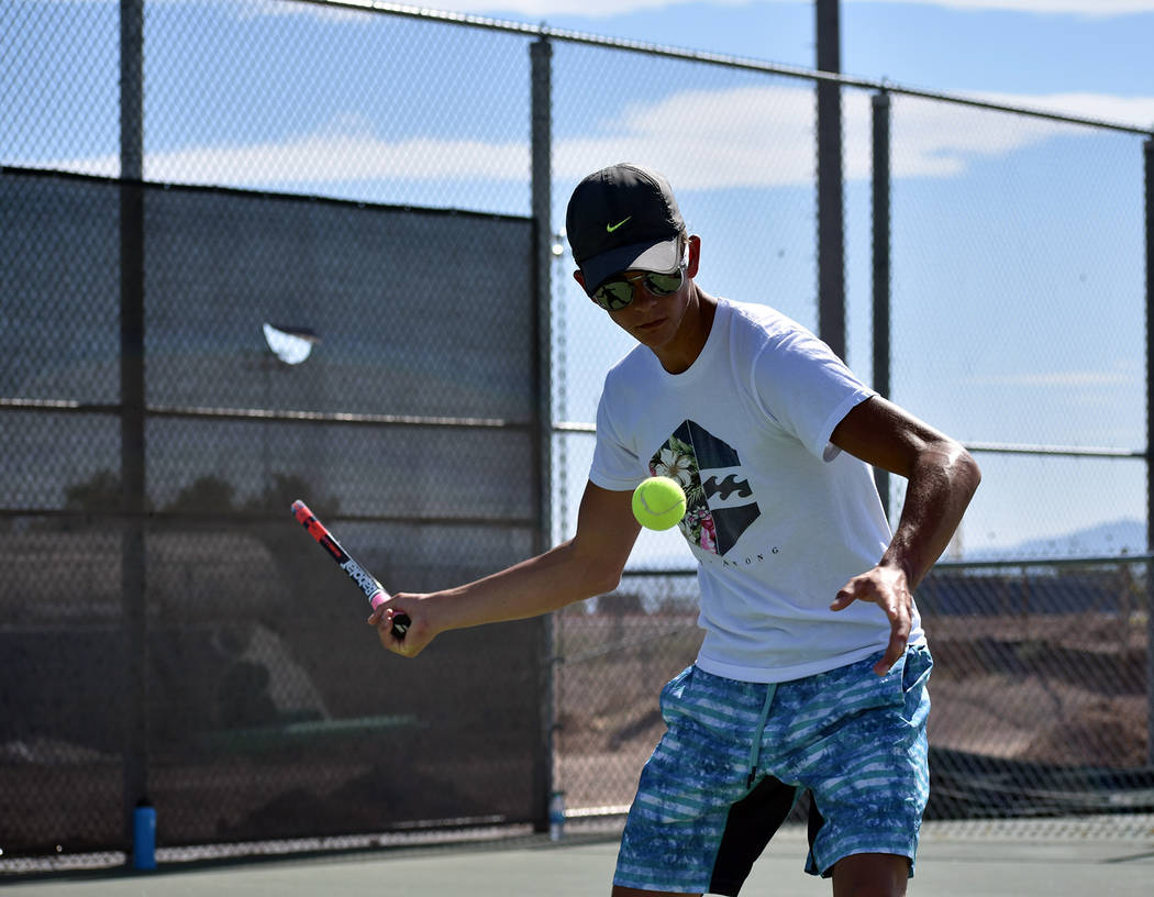 Robert Vendettoli/Boulder City Review Boulder City High School senior singles competitor Andre Pappas returns a serve from Boen Huxford during a recent practice session. Pappas placed fourth at la ...