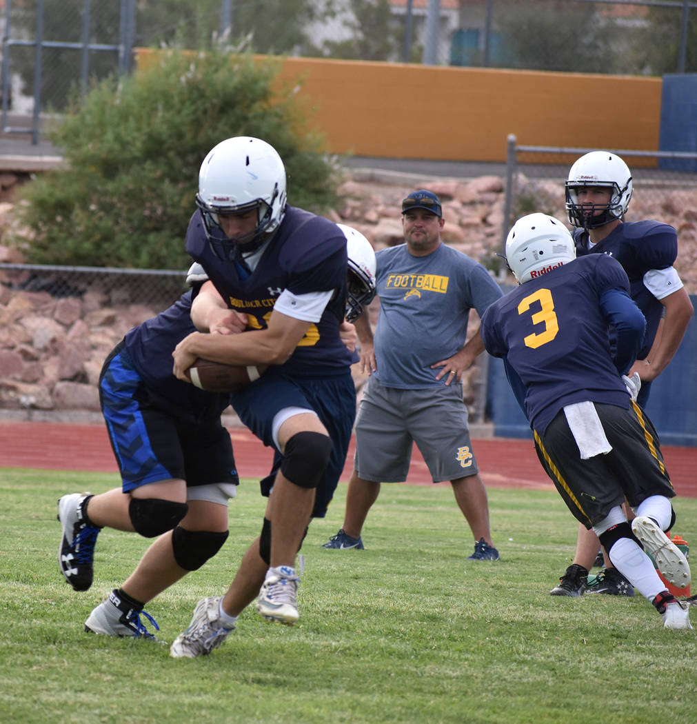 Robert Vendettoli/Boulder City Review Boulder City High School junior running back Thorston Balmer shakes off an oncoming tackler in the backfield during a recent practice session. Balmer returns  ...