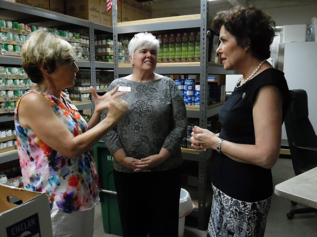 Hali Bernstein Saylor/Boulder City Review Rep. Jacky Rosen, right, toured several places in Boulder City on Aug. 3, including Emergency Aid of Boulder City where she visited the pantry and learned ...