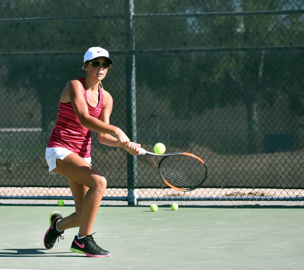 Robert Vendettoli/Boulder City Review Singles competitor Tegan Pappas, a sophomore at Boulder City High School, hones her backhand return during a recent practice session. Pappas placed third at l ...