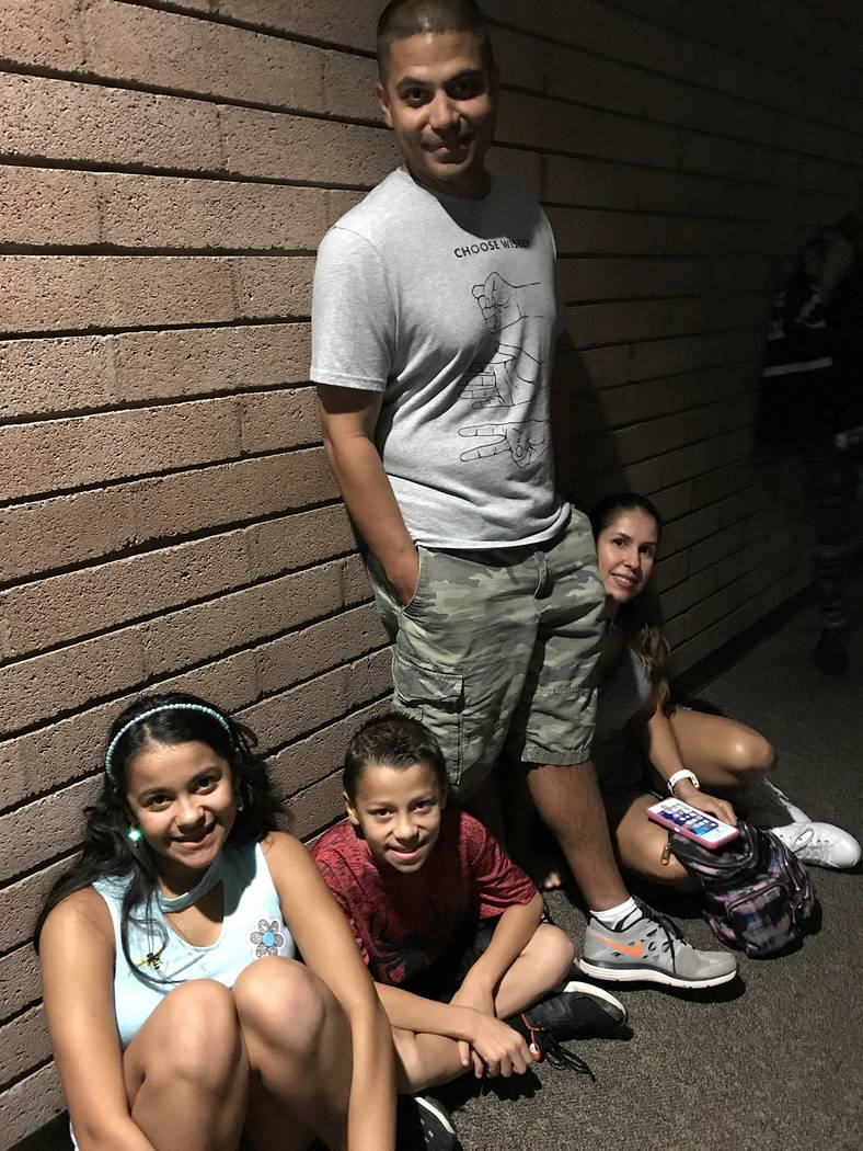 Hali Bernstein Saylor/Boulder City Review The Perez family of Las Vegas, from left, Jaelyz, Gabriel, Josue and Melissa, were among those watching NASA's live broadcast of the solar eclipse on Mond ...