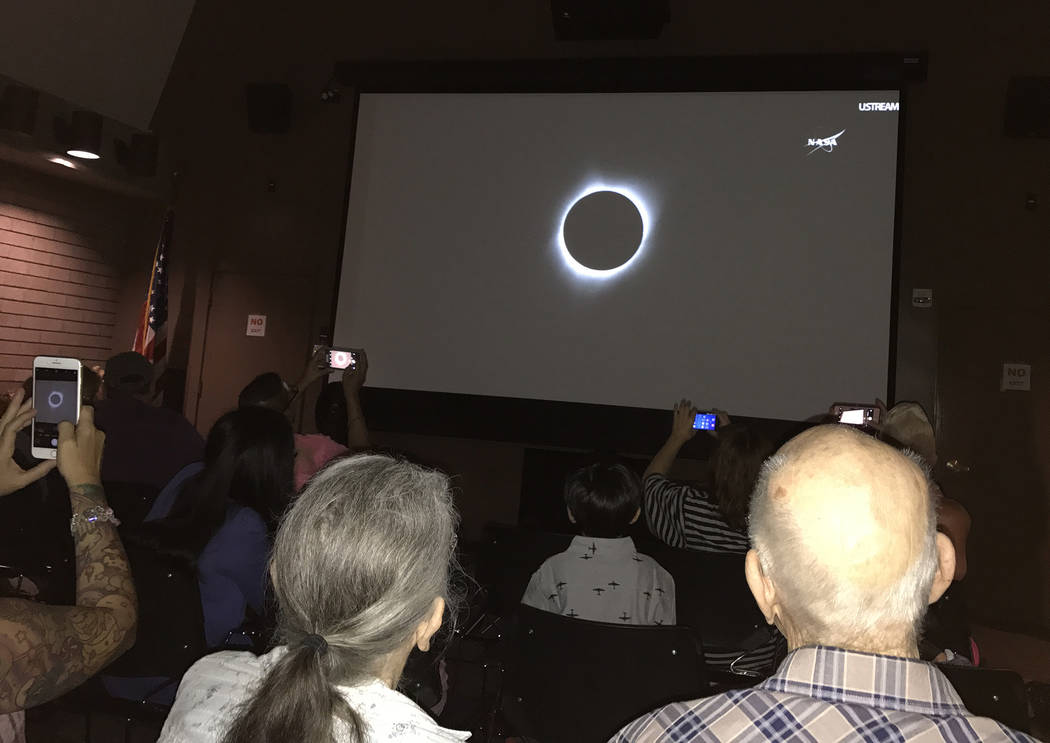 Hali Bernstein Saylor/Boulder City Review A cheer when up from those in the auditorium inside the Alan Bible Visitor Center at Lake Mead National Recreation Area as NASA's live broadcast of Monday ...