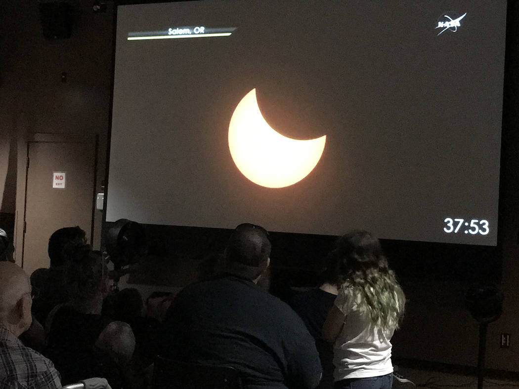Hali Bernstein Saylor/Boulder City Review Several hundred people went to the Alan Bible Visitor Center at Lake Mead National Recreation Area on Monday to watch the solar eclipse. While the area wa ...