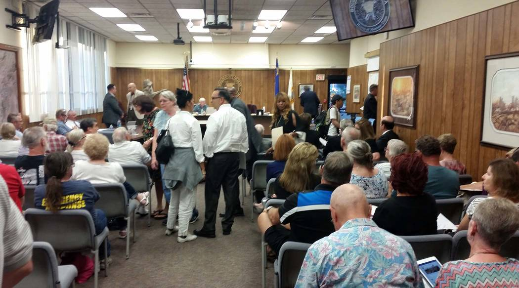 Celia Shortt Goodyear/Boulder City Review People try to find seats in council chambers at City Hall for the packed City Council meeting Tuesday evening.