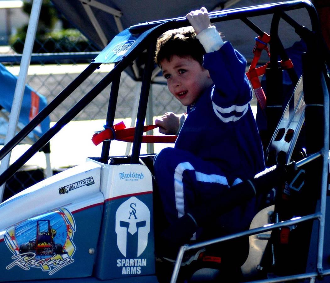 Jeff Hobbs Racer Aedan Hobbs gets into his quarter midget race car and prepares for a race.