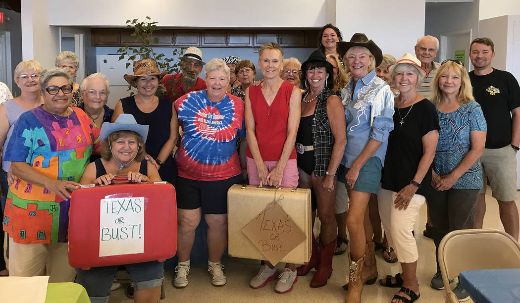Hali Bernstein Saylor/Boulder City Review Terry Grothe, center in red holding suitcase, was bid a fond farewell by her water aerobics students during a luncheon Friday. Grothe, who has been teachi ...