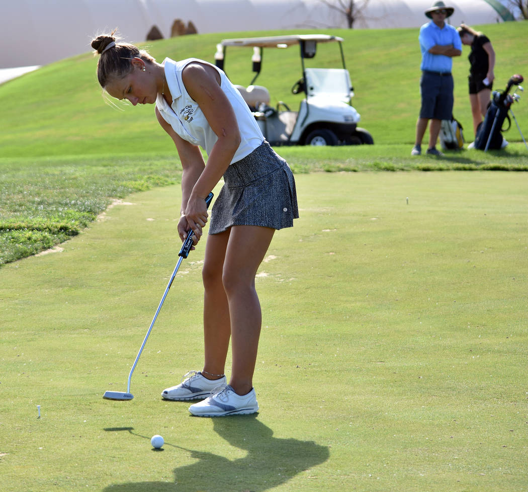 Robert Vendettoli Boulder City High School senior Lani Potter works on her short game at a recent practice. One of the top putters in the 3A classification, Potter won the individual title at last ...