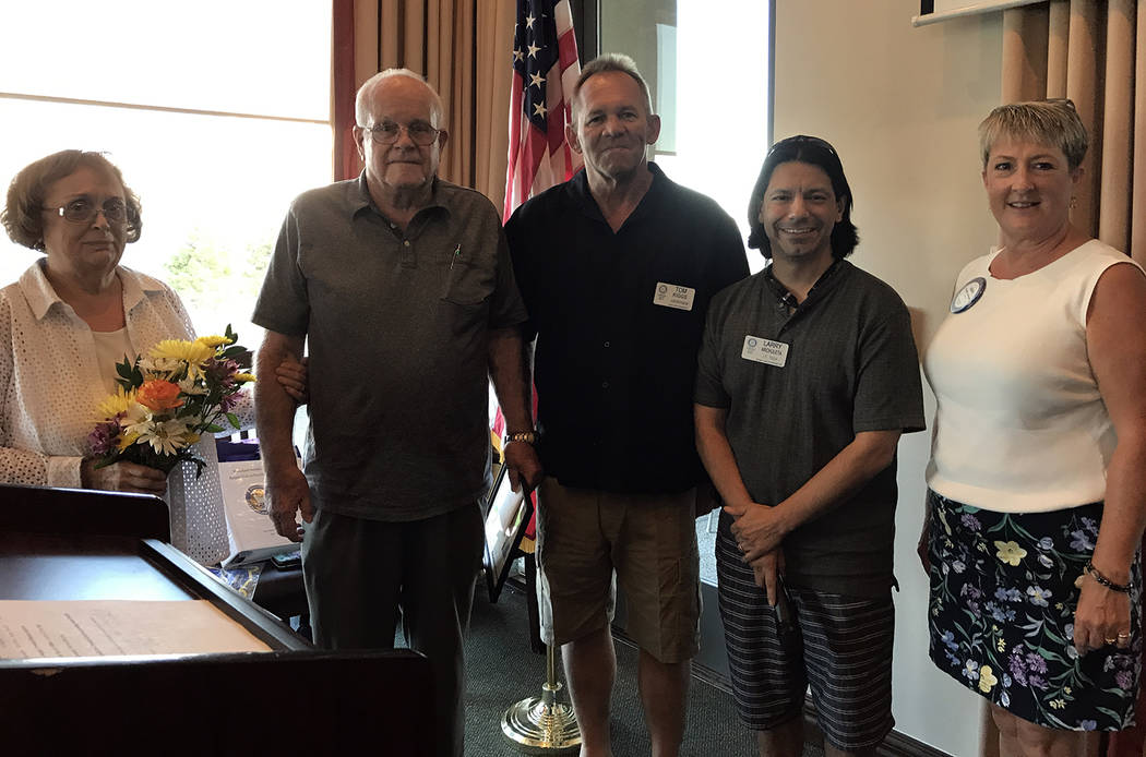 Hali Bernstein Saylor/Boulder City Review Rotary Club of Boulder City recognized the benefactors of its bike rehabilitation program, Maureen and Barry Thibodeau, far left, during their meeting Aug ...
