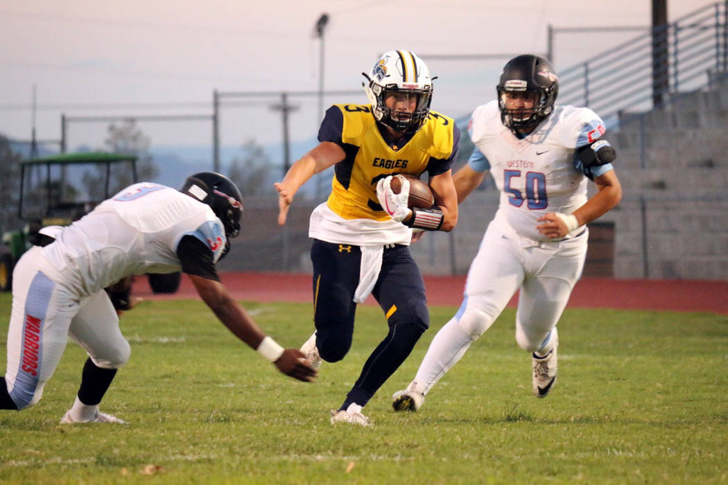 Laura Hubel/Boulder City Review Behind the Eagles' dominating offensive line, quarterback Shaun Jones helped Boulder High High School start off strong with two running touchdowns in the first quar ...