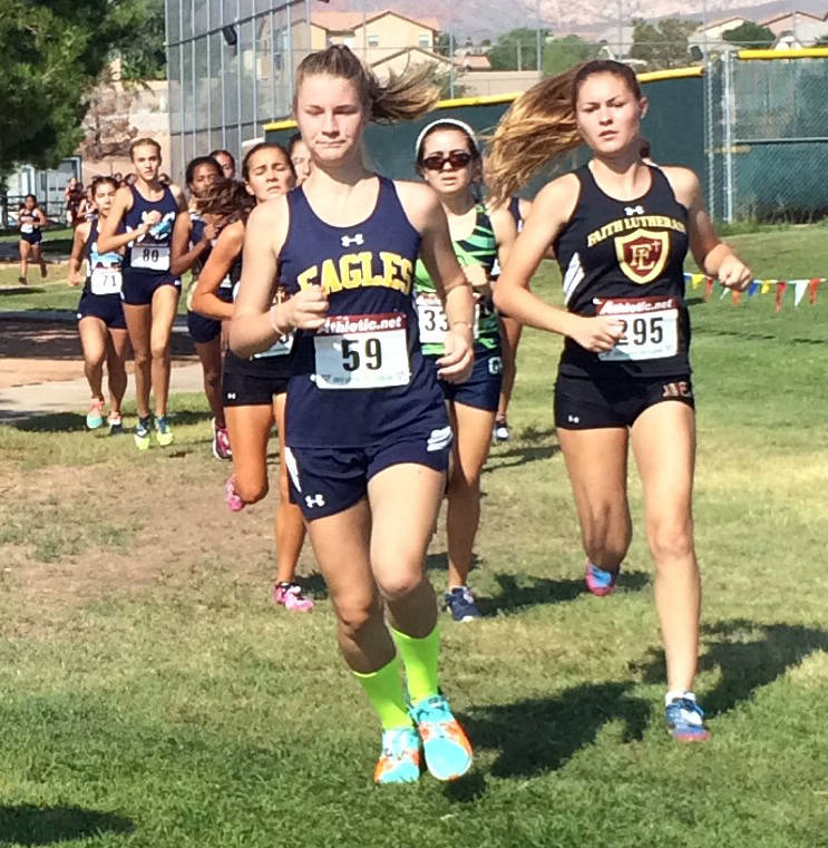Staci Selinger Boulder City High School senior Sierra Selinger leads a herd of runners at Palo Verde High School on Saturday, Sept. 2, 2017. Selinger finished as the second 3A competitor.