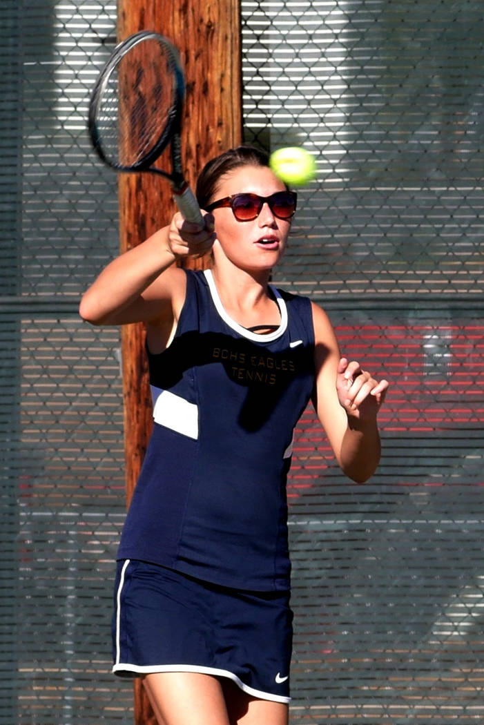Paul Luisi/Boulder City Review Junior Natalie Bowman, seen here during a recent practice session, is new to doubles competition. She paired with sophomore Sophia Morris for a 1-2 finish during Bou ...