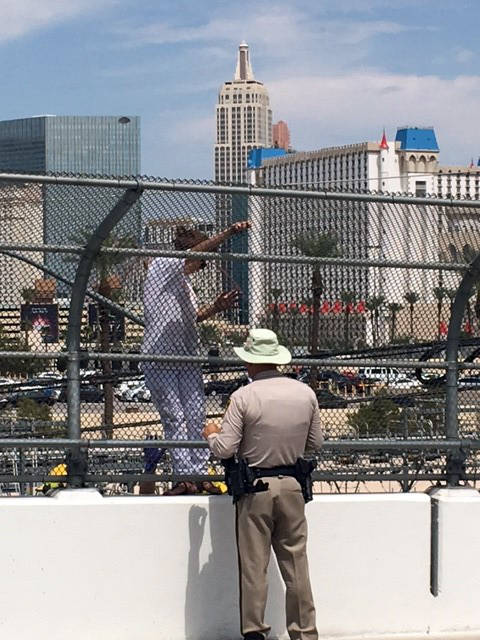 Valarie Vanario-Mullins Officer Timothy Mullins helps a woman who was threatening to jump from an overpass above Interstate 15 in Las Vegas.