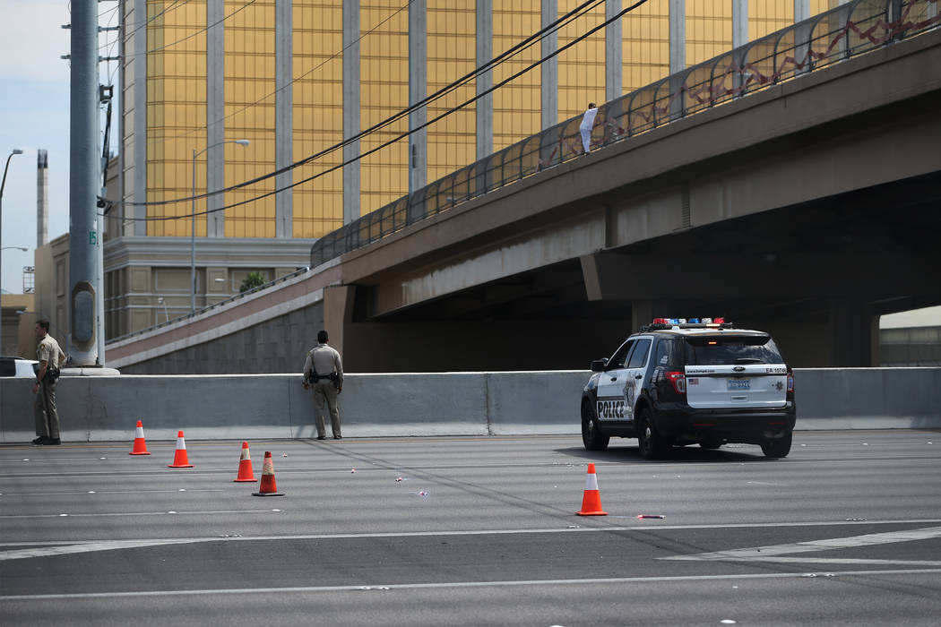 Erik Verduzco/Las Vegas Review-Journal A woman hangs off the Mandalay Bay overpass and above Interstate 15 in Las Vegas, on Monday, Sept. 4. After Metropolitan Police Department officer Timothy Mu ...