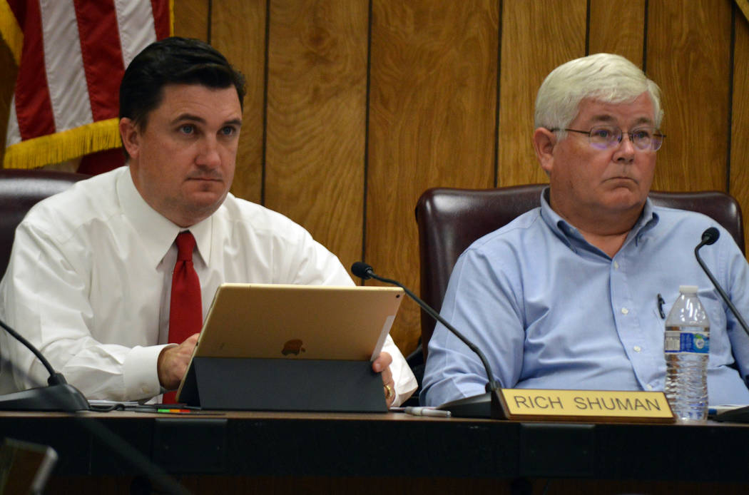 Celia Shortt Goodyear/Boulder City Review Councilmen Rich Shuman, left, and Kiernan McManus listen to a staff presentation about the contract for the city attorney during Tuesday's meeting.