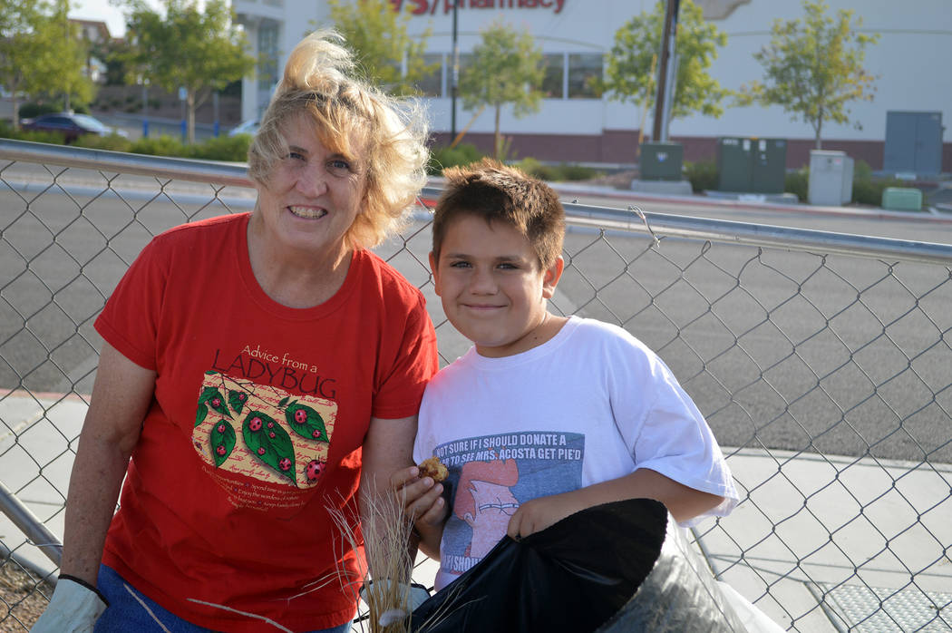 Celia Shortt Goodyear/Boulder City Review Boulder City resident Janet Denning and her grandson Agustin Acosta participated in the first Boulder City Community Cleanup Day on Saturday.