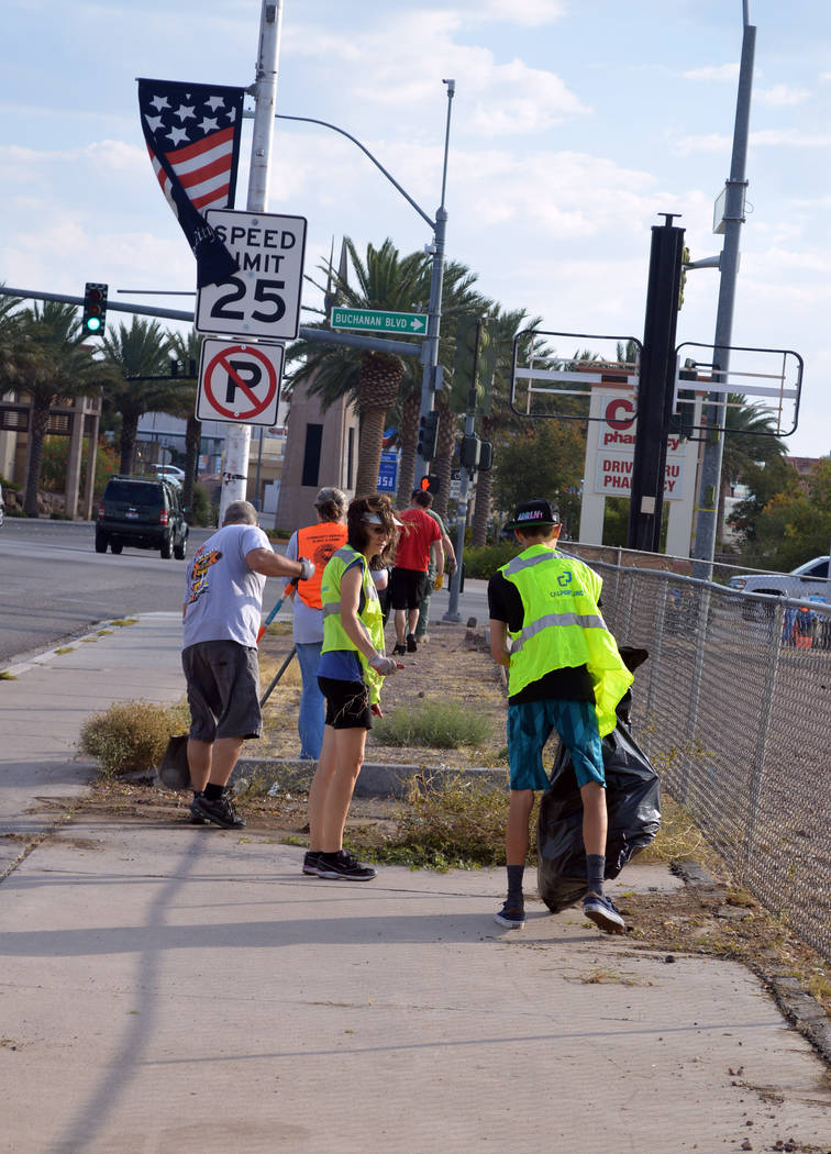 Celia Shortt Goodyear/Boulder City Review Community members clean up the corner of Boulder City Parkway and Buchanan Boulevard on Saturday for the first Boulder City Community Cleanup Day, hosted  ...