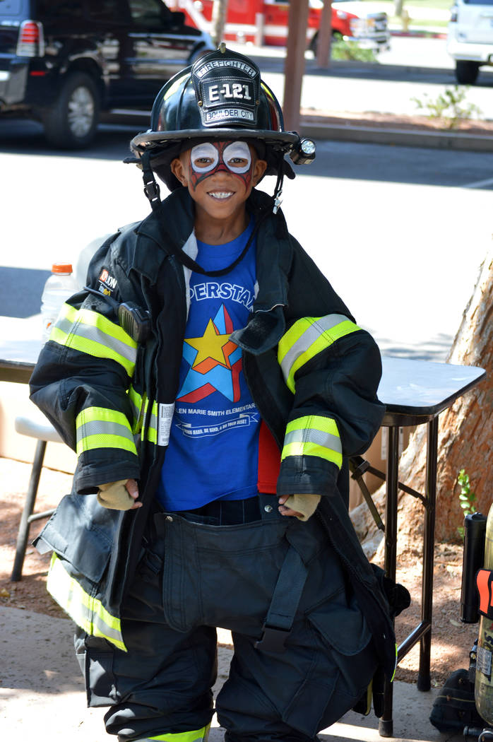 Celia Shortt Goodyear/Boulder City Review Dallas Robinson suits up like a firefighter at the Boulder City Hero & First Responder Appreciation Day on Saturday at Bicentennial Park.