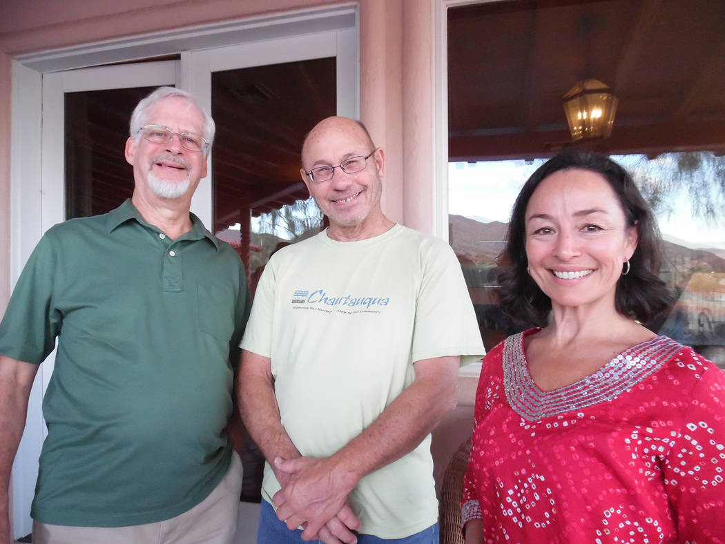 Hali Bernstein Saylor/Boulder City Review Robert Riemer, left, and Rachel Howland visited with Chautauqua scholar Doug Mishler on Friday during a reception prior to his performance as Ernie Pyle f ...