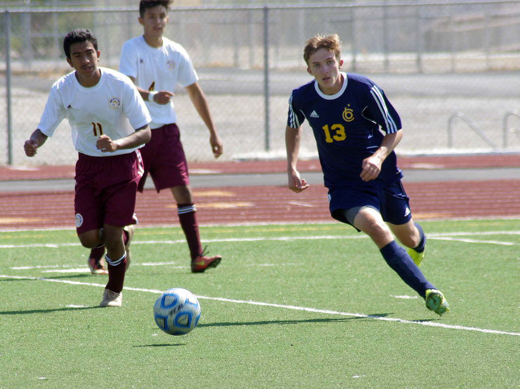 Vern Hee/Pahrump Valley Times Junior Jordan Harris makes a move as Boulder City High School defeats Pahrump Valley 2-1 in a hard-fought match Saturday. Pahrump dominated the first half but didn't  ...