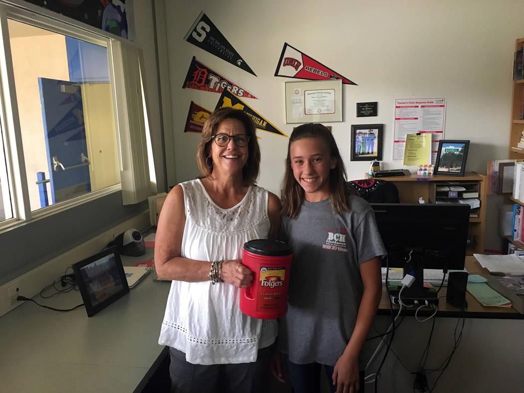 Garrett Junior High School Garrett Junior High School Student Council member Tara Higley shows Maureen Bicknell's Quarter Wars jar during the school's recent fundraiser.