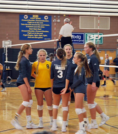 Summer Coyle/Boulder City Review Members of the Boulder City High School Lady Eagles volleyball team huddle after taking the lead against the Legacy Longhorns during the Boulder City Invitational  ...