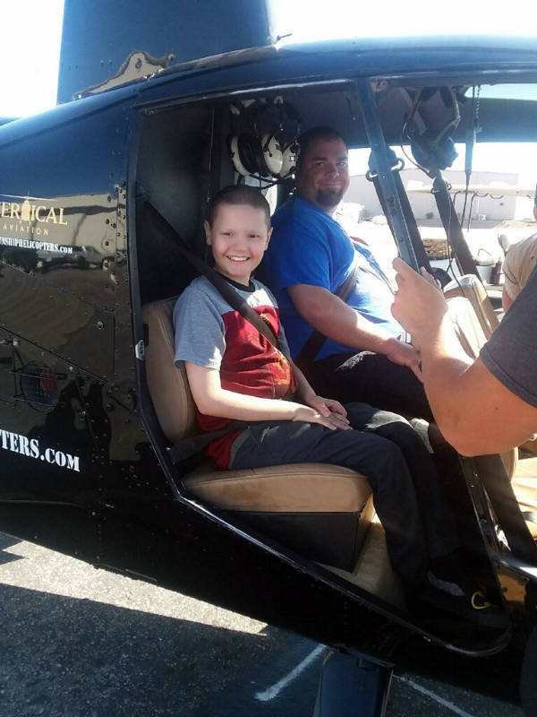 Gunship Helicopters Nik Davison and his dad, Calvin, get ready to go for a helicopter ride.