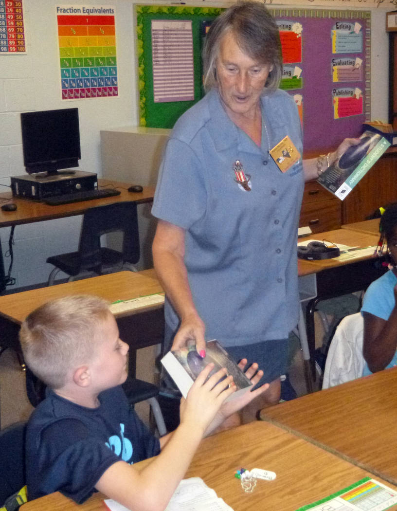 Celia Shortt Goodyear/Boulder City Review Karen Murray of the Boulder City Elks Lodge presents a dictionary to Branch Danko, a third-grade student at King Elementary School on Friday, Sept. 22.