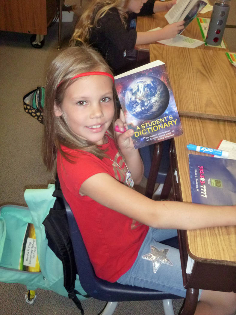 Celia Shortt Goodyear/Boulder City Review Third-grader Alexis Powers shows off the dictionary she was given by the Boulder City Elks Lodge on Friday, Sept. 22.