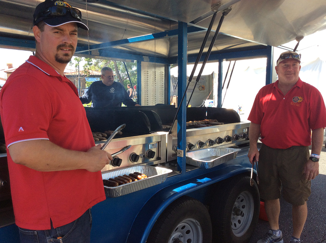 Hali Bernstein Saylor/Boulder City Review Rotarians Jim Parsons, left, and Greg Spinkelink manned the grills Saturday at Boulder City Sunrise Rotary's 18th annual Wurstfest. In the background is ...