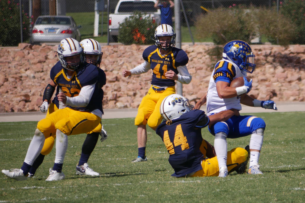 Paul Luisi/Boulder City Review Boulder City High School junior Gino Carroll (No. 44) tackles a Moapa Valley Pirate in Saturday's 16-0 loss at home.