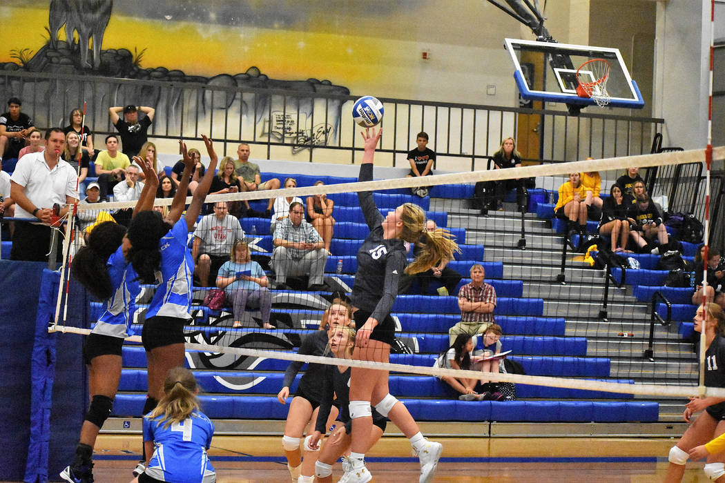 Robert Vendettoli/Boulder City Review Boulder City High School senior Maggie Roe, at right, goes all in against Basic High School earlier this season. A captain for the team, Roe led the way with  ...