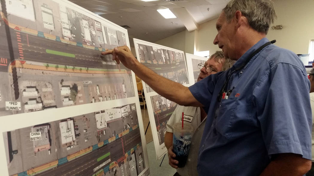 Celia Shortt Goodyear/Boulder City Review Charles Williams of B &J Body Shop, left, and Chris Gatlin, owner of Woodchucks, look at design plans for the complete streets project at a public inp ...