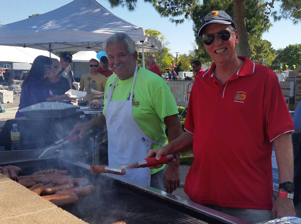 Celia Shortt Goodyear/Boulder City Review Dale Ryan, left, and Robert Merrell grill bratwursts and beef hot dogs at the 21st annual Wurstfest held Saturday in Bicentennial Park.