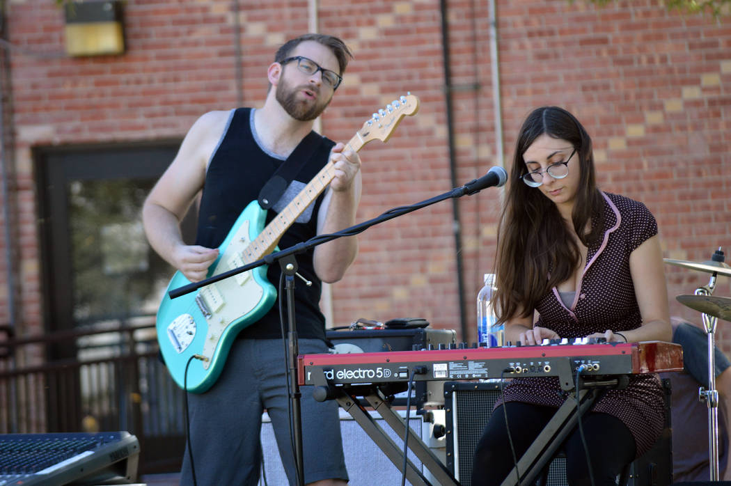 Celia Shortt Goodyear/Boulder City Review Brian Cantrell of Same Sex Mary plays the guitar while Tsvetelina Stefanova plays the keyboard during the band's performance at Wurstfest on Saturday.