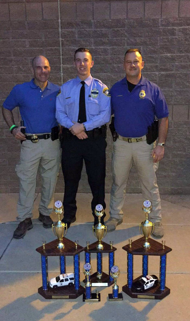 Bailey Thompson Boulder City Explorer Bailey Thompson, center, relied on his training to help victims at Sunday's mass shooting in Las Vegas. Boulder City Police Officer Scott Pastore, left, and B ...
