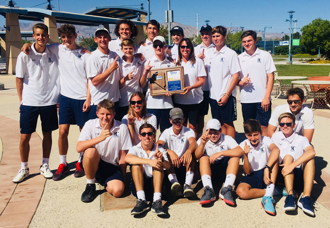 Rachelle Huxford Members of Boulder City High School's boys tennis team celebrate their regional title win after competing in the tournament Oct. 5.