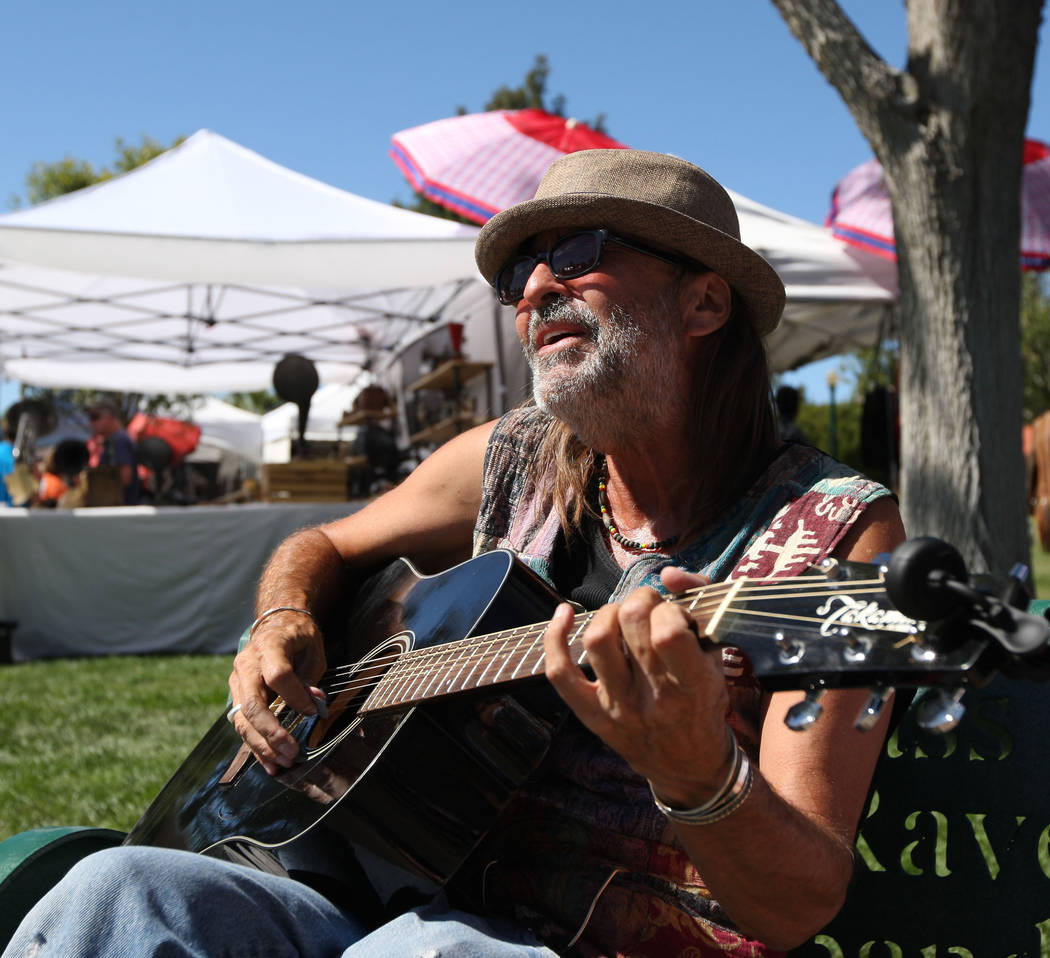 """Gabriella Benavidez/Las Vegas Review-Journal Musician Randy White sings """"My Girl"""" by The Temptations during Art in the Park in Boulder City on Saturday."""