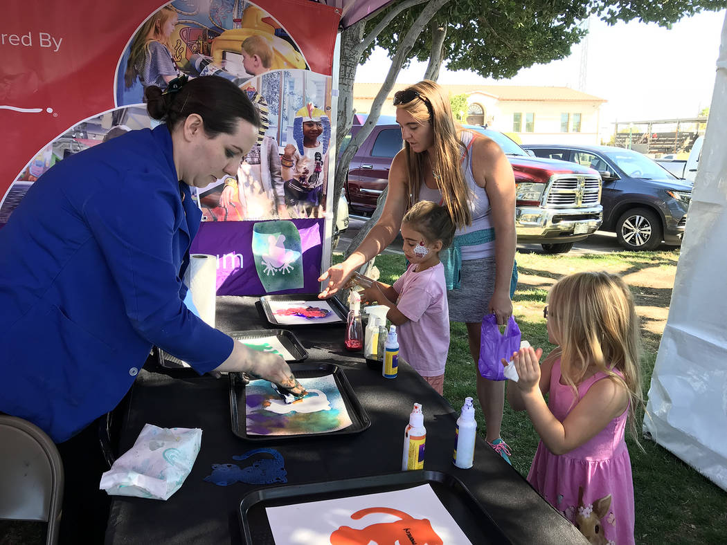 Hali Bernstein Saylor/Boulder City Review Angela Burnett, left, of Children's Discovery Museum in Las Vegas, helps Teagan Holmes, 6, of Las Vegas, far right, create a painting of her own as Sophia ...
