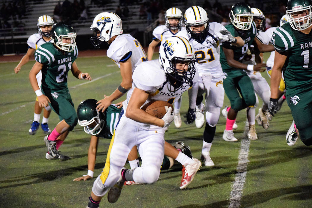 Robert Vendettoli/Boulder City Review Boulder City High School senior receiver Briggs Huxford returns a third-quarter kickoff 81 yards for a touchdown. Huxford finished with three touchdowns, help ...